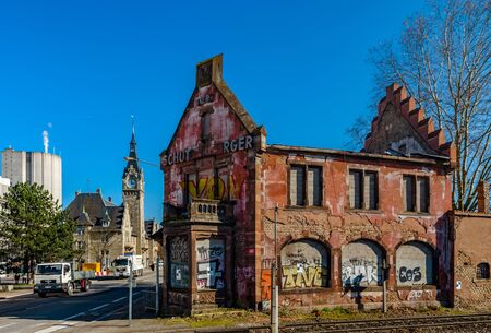 Editorial: 14th March, Strasbourg, France. Old abandoned ruined brick house near insdustrial zone of city