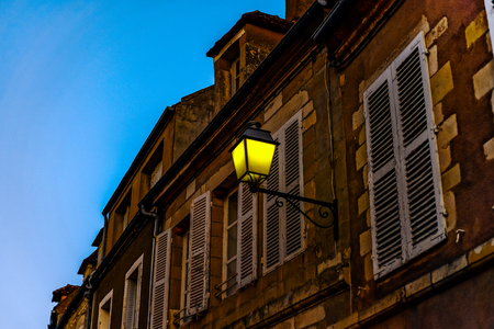 Evening time in old french city Vezelay. Light of old-styled street lantern.. France. Editorial