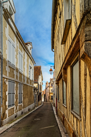 Old buildings in Auxerre, street view in sunny spring day, France