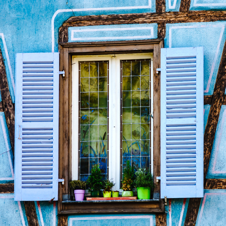 Old beautiful windows in historical center of Colmar, alsacien style, France