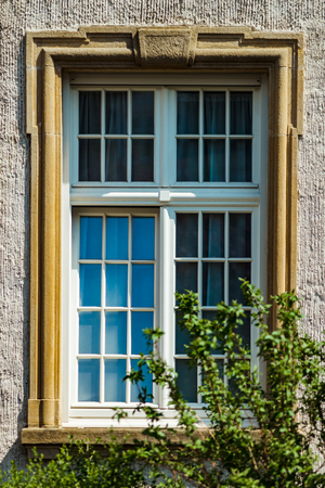 Beautiful old windows in historical center of Strasbourg, architectural details