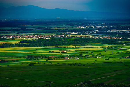 Thundery weather befor the storm over the green valley in Alsace, aerial view, vivid colors, France