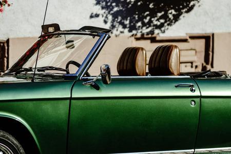 Beautiful retro green car on the street, sunny day, France