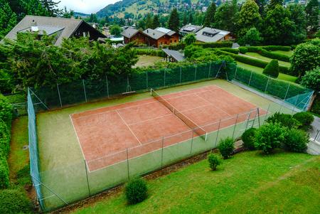 Tennis court aerial view, little village in Swiss