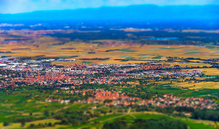 Beautiful tilt-shift aerial view to the colorful valley from the top of the hill, Alsace, France