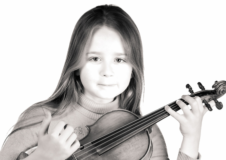 Cute emotive little girl with violin, music and educational concept, isolated on white
