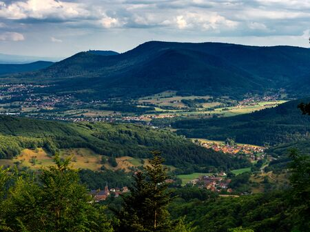 Spacious mountain landscape. A view from the mountain to the valley of Rhine and the village of Alsace. France. Standard-Bild
