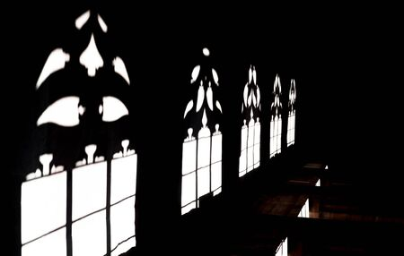 Shadows in Basel Minster, sunlight through the gothic windows, Swiss