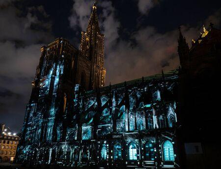 Laser lighting show on the walls of Cathedral Notre Dame de Strasbourg, France