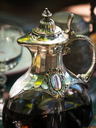 Wine jug made of crystal and silver. Antique item for the table. Elegant rich dishes for decorating a feast. France. Standard-Bild