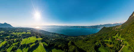 Geneva lake aerial panoramic view from drone, sunset time, France