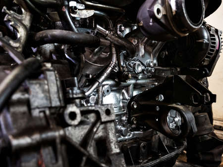 Go through the engine. Renew the engine. Repair the engine. Tools, oil, nozzles, cylinder block, painting, cleaning, repair of diesel internal combustion engine for a car.