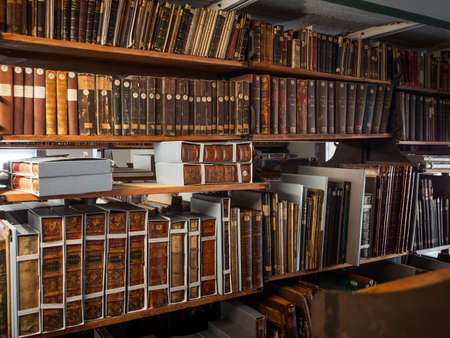 Antique books in the depositories of the Strasbourg library. History, learning, an opportunity to touch the past. Editorial
