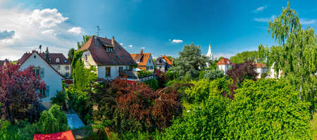 Panoramic view of the residential area of Strasbourg. Summer sun and bright colors of greenery and tiled roofs. France