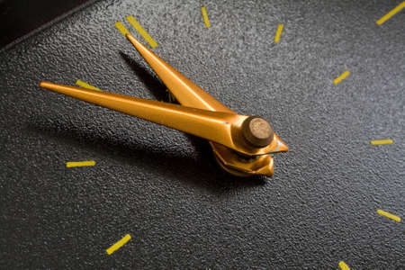 past midnight: yellow clocks on the black dial