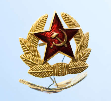 Military badge from the former Soviet Union and reflection on a mirror photo