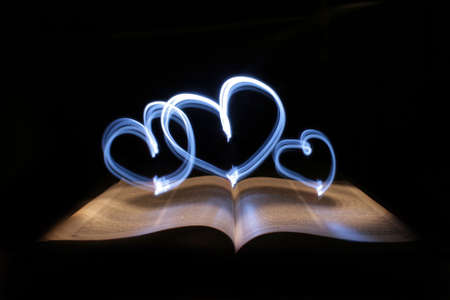 blue hearts and book, made from light Stock Photo