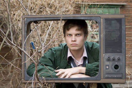 infomercial: serious man in old tv box, on street