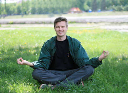 Young Man Meditate Outdoor on a green grass Stock Photo - 4890202