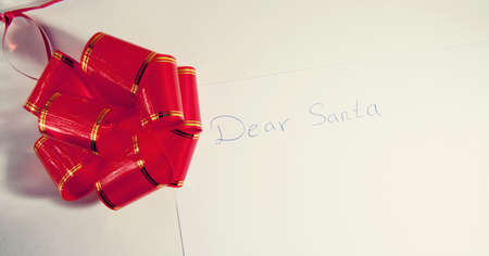 Letter to Santa written by child on white paper photo