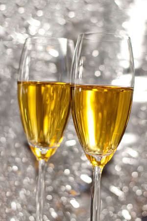 Pair of champagne flutes making a toast on beautiful background Stock Photo - 5988415