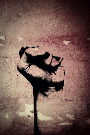 Russian fist on an abandoned Cement wall Standard-Bild