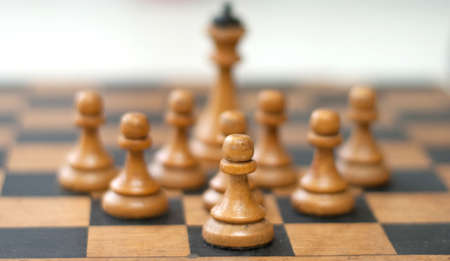 chellange: chess piece isolated on light background blurred figures