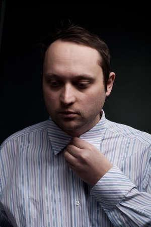 portrait of serious man set the collar photo