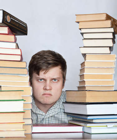 discontent: Young crazy discontent student between books