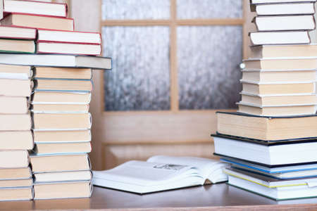 close-up of working place with books on door background photo