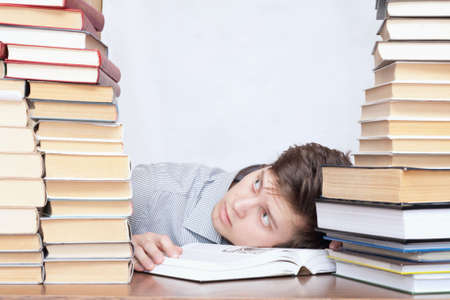 discontent: Young crazy tired discontent student between books