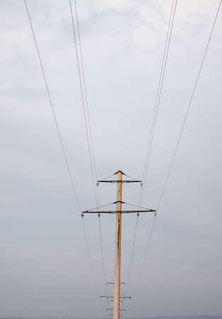 electric power lines on cloudy background photo