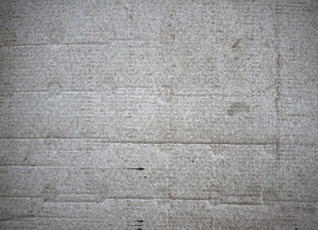 Grey corrugated cardboard useful as a background photo
