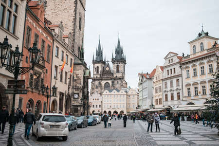 old town square: PRAGUE, CZECH REPUBLIC - JANUARY 9: Group of people walking on Old Town Square in Prague on january 9, 2015 in Prague. Christmas holiday continuing for tourists Editorial