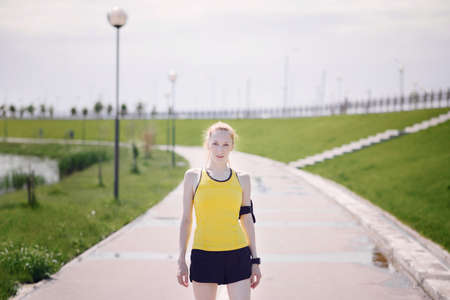 yellow shirt: Young woman portrait in sports clothes. Girl in yellow shirt Stock Photo