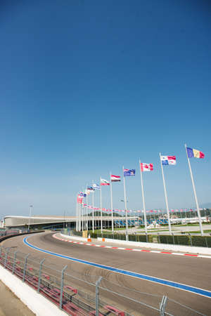 Sochi, Russia - September 6, 2018: Part of Sochi Autodrom with Flags Different Countries. Track f1 wich Located in Olympic Park in Adler.