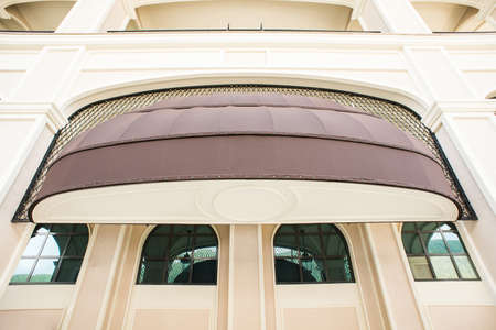 Brown awning Over Cafe Window. Cafe Tent. Canopy Sunshade for Store Window, Outdoor Market Awnings.