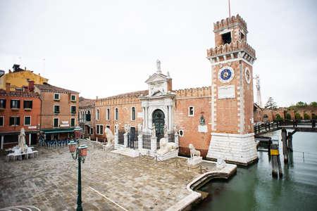 Venice. Italy - May 13, 2019: The Main Gate at the Venetian Arsenal (Arsenale di Venezia). View from Ponte del Paradiso. Canal Rio dell Arsenale. Editorial