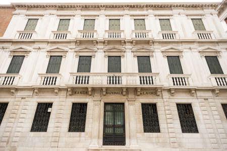 Venice. Italy - May 13, 2019: Facade of Banca Nazionale del Lavoro in Venice. Italy. Old Building. Editorial