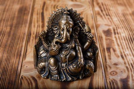 Ganesha on wooden background Stock Photo