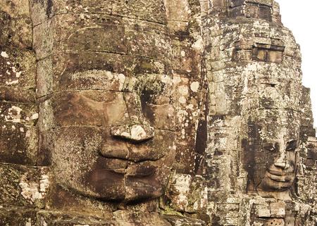 angkor thom: Carved Heads At Bayon Temple, Angkor Thom, Cambodia Stock Photo