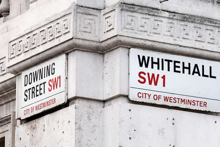 Signs on the corner of Whitehall and Downing Street, in the City of Westminster, London  This area is the home of British government, with the Prime Minister photo