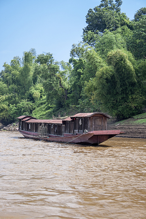 Boats On The Mekong River , Laos photo