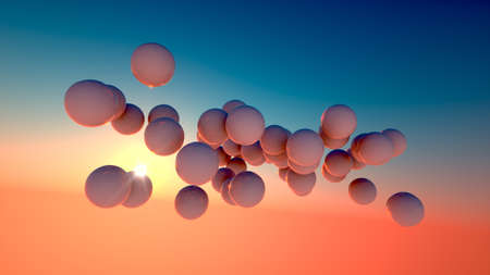 bouncing: white ball floating in a sunset sky Stock Photo