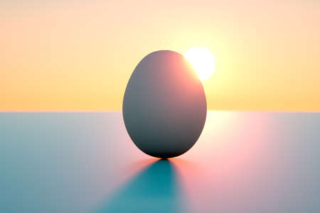 Sunrise behind an egg as a metaphore for new beginning Stock Photo