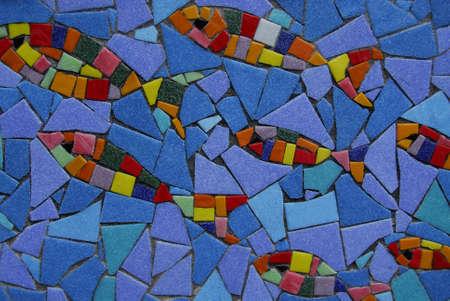 Mosaic fish swimming up stream