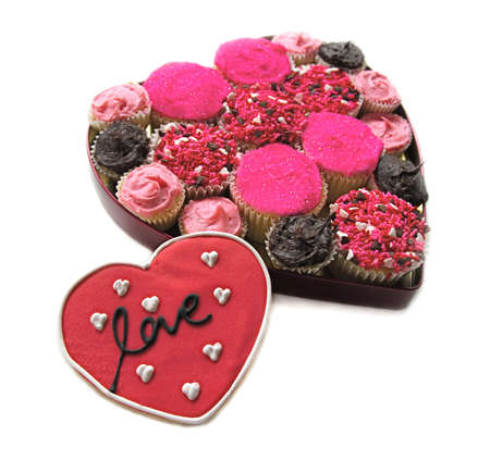Homemade Cupcakes in heart shape with Love Cookie photo