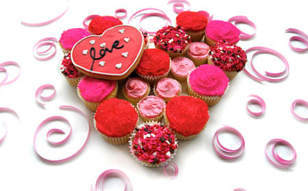 Bright Pink and Red cupcakes with heart love cookie