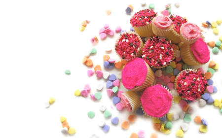 Tumble of Valentine cupcakes with candy hearts photo