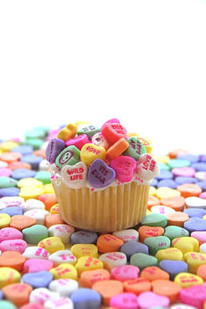 Candy hearts on cupcake photo